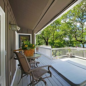 a home with a deck overlooking Lewis Smith Lake